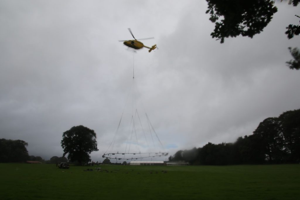 Helicopter installing the Fountain in the Lake